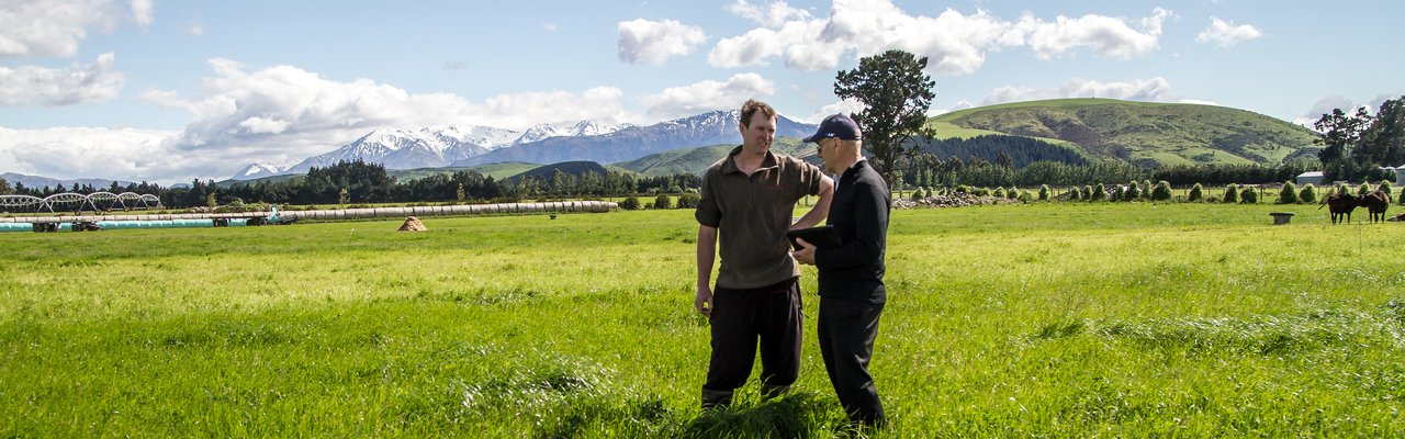 FSM talking to farmer in paddock